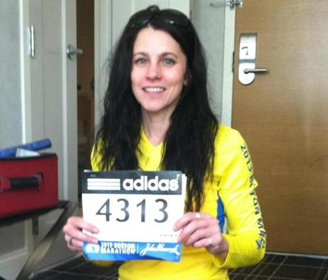 Stacy Shaw (shown before the race, in her hotel room) is grateful for the push spectators gave her.